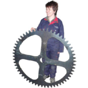 A large gear cog wheel waterjet cut from steel plate