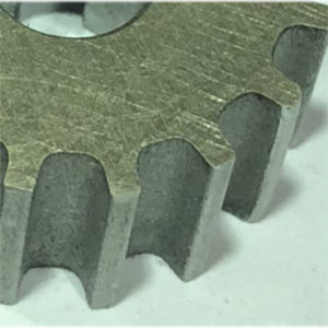 a close up of a waterjet cut gear cog