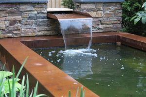 Corten steel fountain water spout