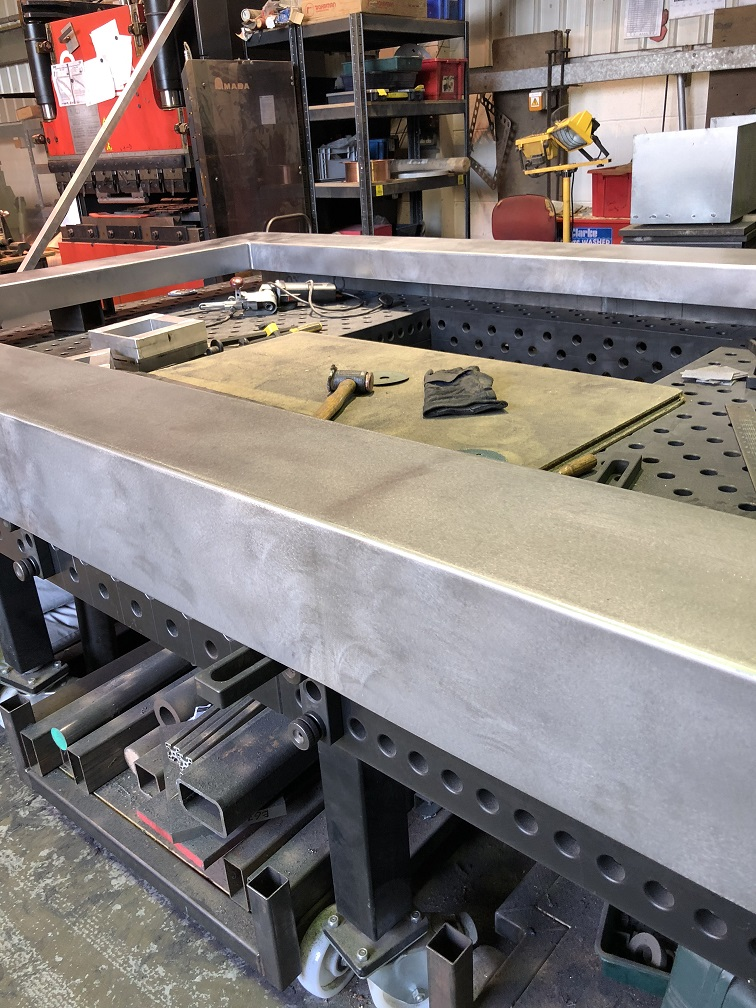 Corten steel wall Capping feature being welded and ground