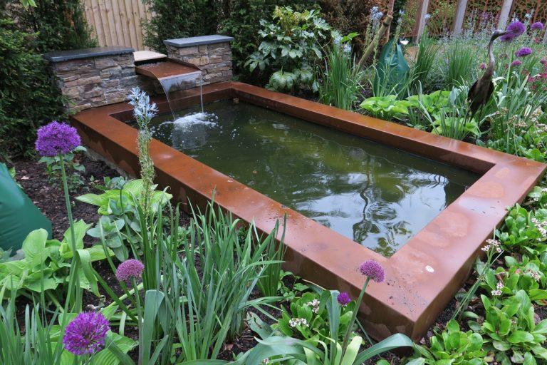 rusty corten steel garden pond wall capping feature